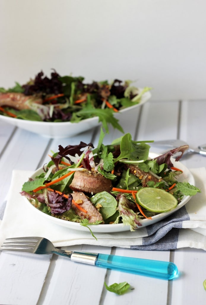 Thai beef salad - A colorful Thai beef salad packed with flavors of fish sauce, shallots, lime juice, mint, cilantro, lemongrass, cucumbers, carrots and wonderful garnishes.