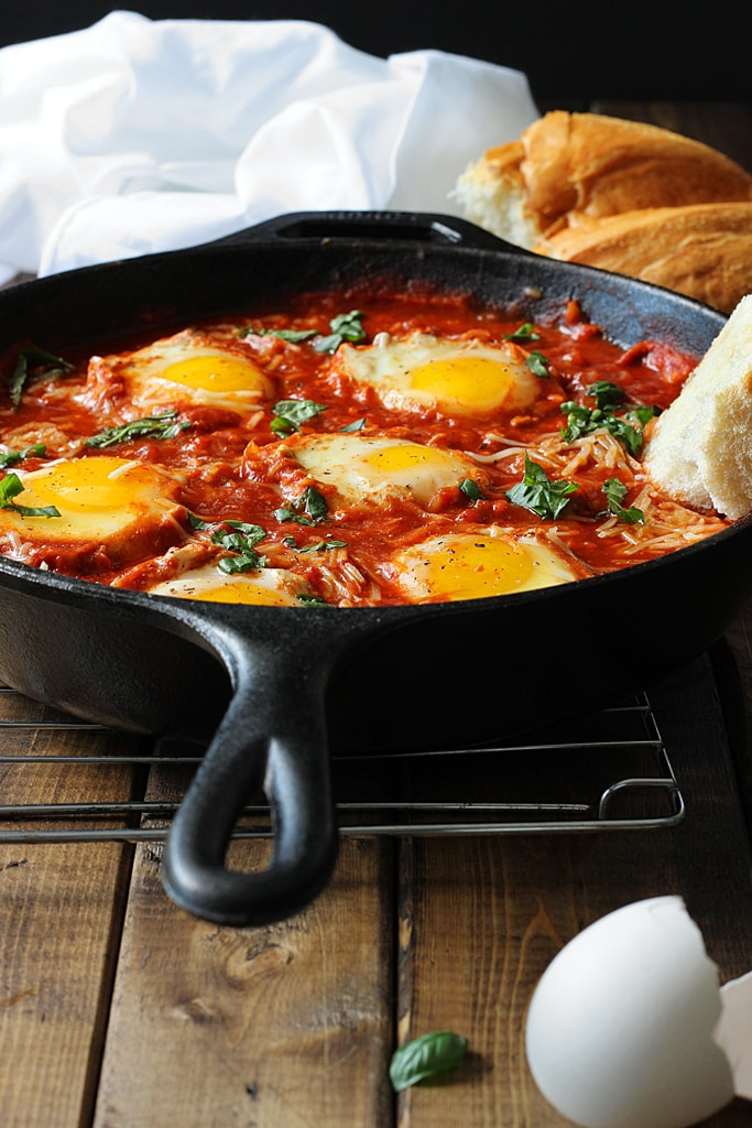 Eggs in Hell are a quick and spicy way to enjoy your eggs in the morning. With plenty of spices, Parmesan cheese and eggs simmered in tomato sauce.