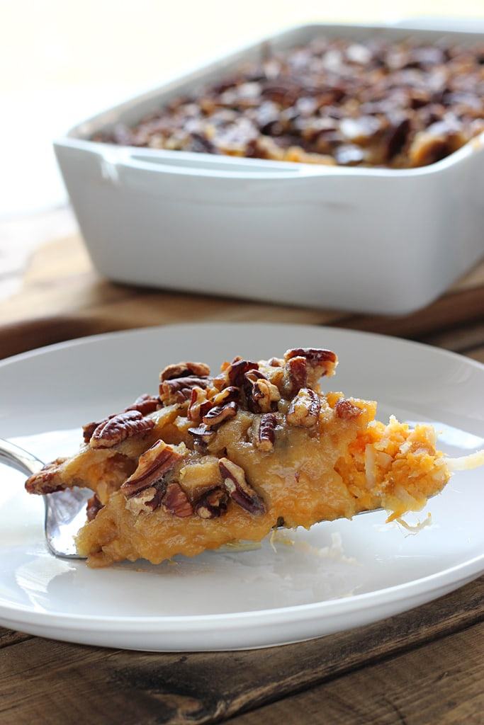 Sweet potato casserole is delicious and comforting, sweet but not too decadent.  With a crunchy fudge topping and festive sweet potato and coconut filling.