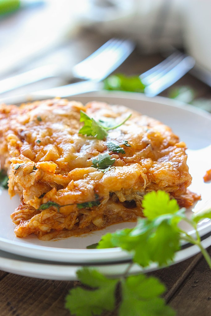 Enjoy the taste of enchiladas at home with tons of cheese! Here's a chicken enchilada casserole that's super easy to make and customize.