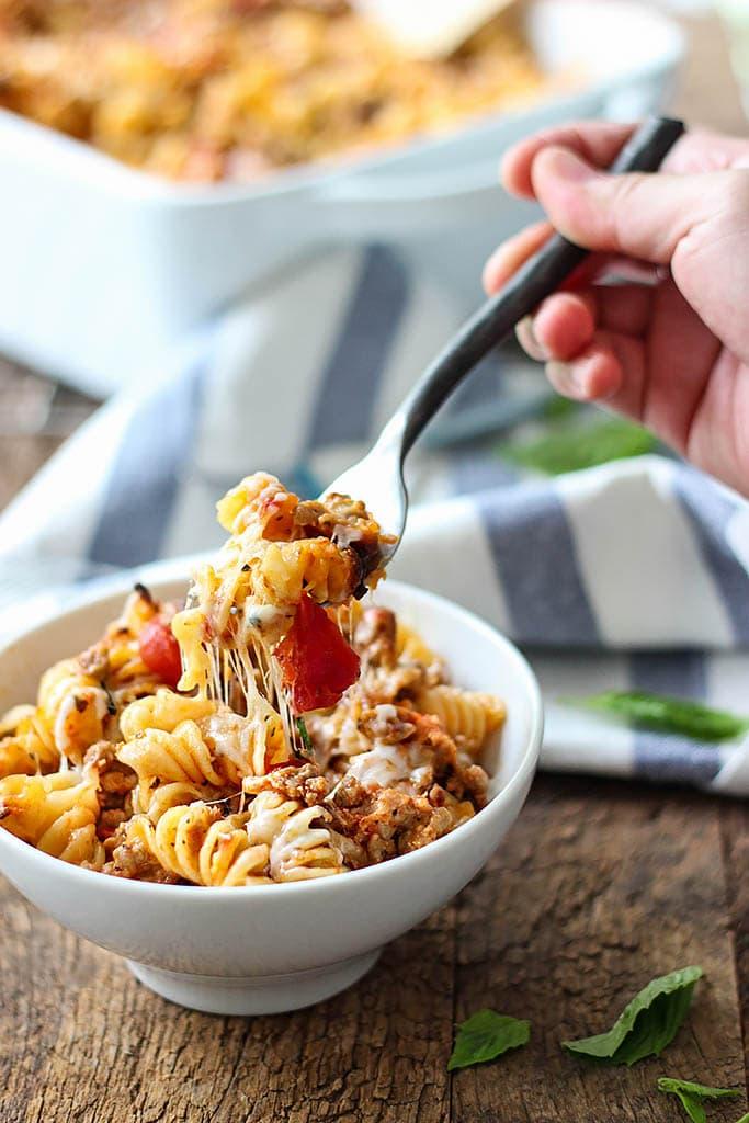 A cheesy hot Italian pasta bake with a spiced savory and sweet marinara sauce, hot Italian flavors and plenty of cheese.