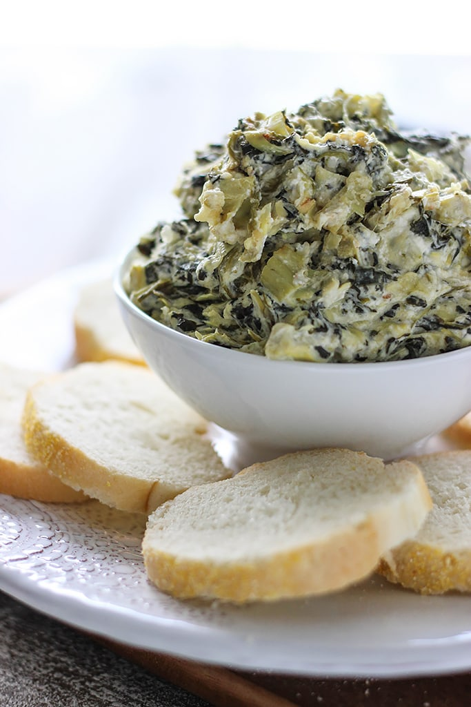 Seriously easy and seriously yummy. This homemade slow cooker spinach and artichoke dip feeds a crowd of ten!