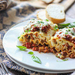 Make some individual sized meaty and cheesy lasagna roll ups. A fun twist on the classic with enough to serve a crowd.