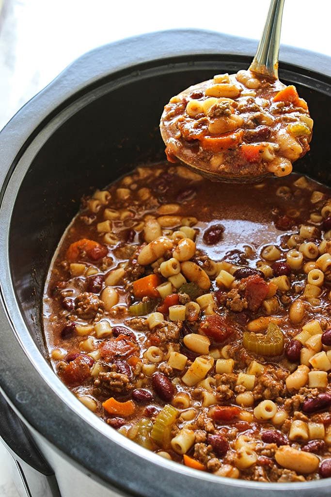 Break out the bowls for some comfort. This slow cooker beef and beans pasta soup has everything you need. Don't forget the Parmesan.