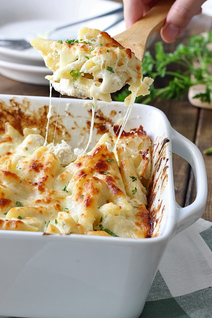 Creamy, cheesy packed chicken Alfredo pasta bake with three kinds of cheese and plenty to go around. Lots of gooey, stringy cheese in this fall casserole!